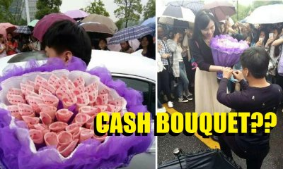 Young Man Proposed To Girlfriend With Bouquet of Cash - World Of Buzz