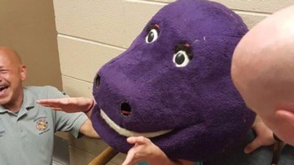 Prank Gone Very Wrong when Teen Traps Herself in Huge Barney Head - World Of Buzz 2