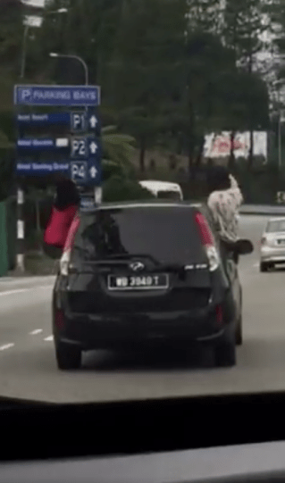 Malaysian Netizens in Disbelief As 4 Girls Literally Hang Out of Car Window - World Of Buzz 1