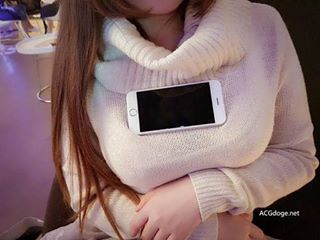 Ladies All Over Asia Are Placing Their Smartphones on Their Chests in New Bizarre Trend - World Of Buzz