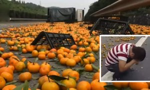 Chinese Man Cries As Villagers Steal His Oranges After His Lorry Overturned. - World Of Buzz 7