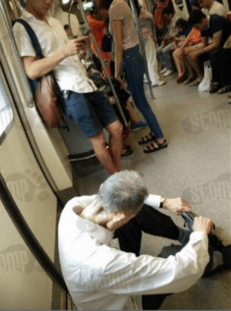 Elderly Man Forced To Sit on Train Floor After No One Offered Him A Seat - World Of Buzz