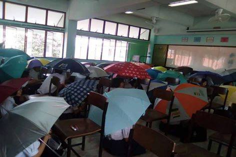 Teacher Asks Students To Open Umbrella To Prevent Cheating During Exam - World Of Buzz 2