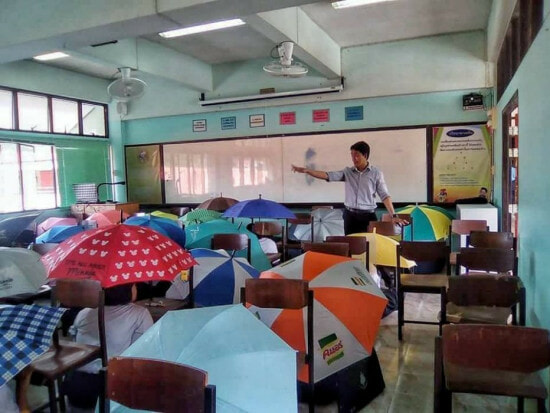 Teacher Asks Students To Open Umbrella To Prevent Cheating During Exam - World Of Buzz 3