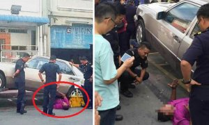 Malaysian Man Desperately Lies Under Car To Prevent It From Being Towed Away - World Of Buzz