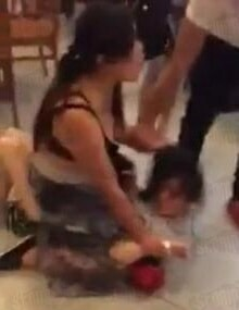 Woman Hits and Strips Mistress in Starbucks as Husband and Daughter Watches - World Of Buzz 1