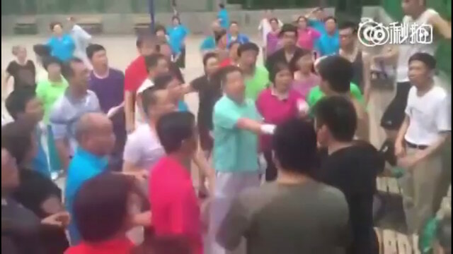 Basketball Players and Dancing Aunties Hold Turf War Over Basketball Court - World Of Buzz