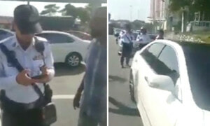 Malaysian Men Accuse Policemen for Having Double Standard in Viral Video - World Of Buzz