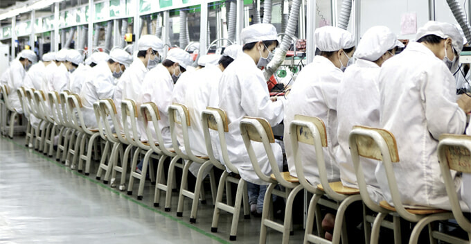 Man Slips Into Factory Manufacturing iPhone in China and Discovers The Brutal Truths - WORLD OF BUZZ