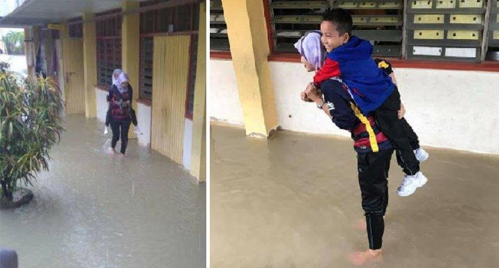 Amazing Malaysian Teacher Carries Schoolchildren Across Flood Waters to Safety - WORLD OF BUZZ 7