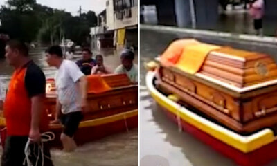 Family Forced to Use Boat to Transport Deceased Relative's Coffin Due to Penang Floods - WORLD OF BUZZ 2