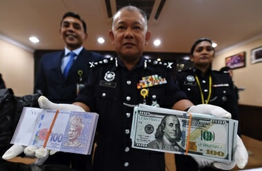 Cops Seize RM1.3 Million Fake Cash From Counterfeit Money Syndicate in Nilai - WORLD OF BUZZ 1