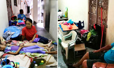 Family of Four Forcefully Evicted and Sleeps on Concrete Floor at Corridor on Christmas - WORLD OF BUZZ