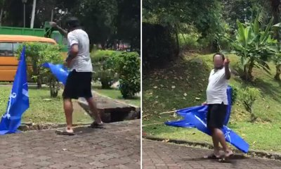 Police are Searching for 'Angry' Man Who Removed BN Flags in TTDI - WORLD OF BUZZ 3