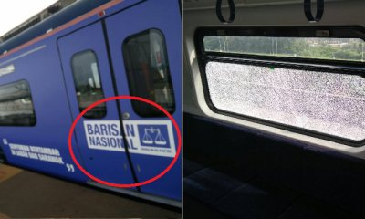 KTM Train Plastered with BN Stickers Allegedly Vandalised by Angry M'sians - WORLD OF BUZZ