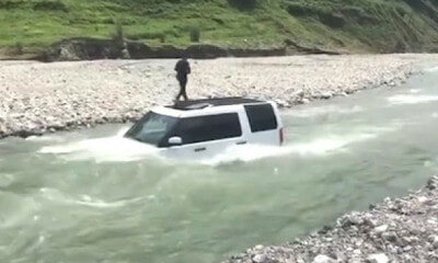 Man Washes Expensive Land Rover by River to Save RM12, Car Ends Up Getting Flooded - WORLD OF BUZZ