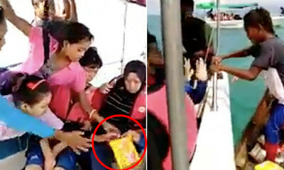 Viral Video Shows Bajau Kids Shockingly Climb onto Tourist Boat to Beg for Food - WORLD OF BUZZ