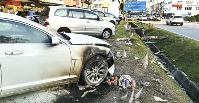 Luxury Car Damaged After Owner Unknowingly Parked  at the Spot Where Joss Paper Was Burning - WORLD OF BUZZ