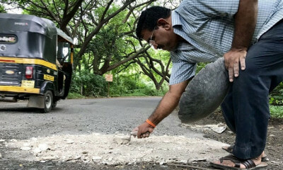 Father Goes Around Filling Up Potholes In Honour Of His Dead Son - WORLD OF BUZZ