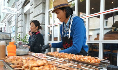 Man Quits His Boring Job as a Banker to Sell Chicken Satay in Switzerland - WORLD OF BUZZ