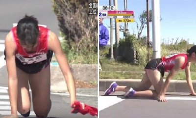 Marathon Runner Shows Great Sportsmanship By Crawling to Finish Line Even With a Fractured Leg - WORLD OF BUZZ 3