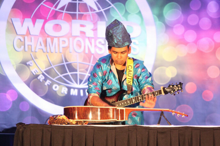 This 16yo M'sian Made It to World Championship By Playing Guitar Blindfolded and with Two Guitars - WORLD OF BUZZ 4