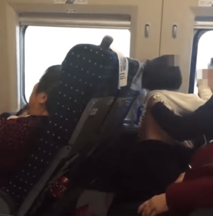 Train Passengers Shocked By Father Kissing and Inserting Hands In Young Daughter's Pants - WORLD OF BUZZ