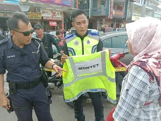 Litterbugs At Semporna Punished With 'monkey' Vest And Forced To Clean Up - World Of Buzz