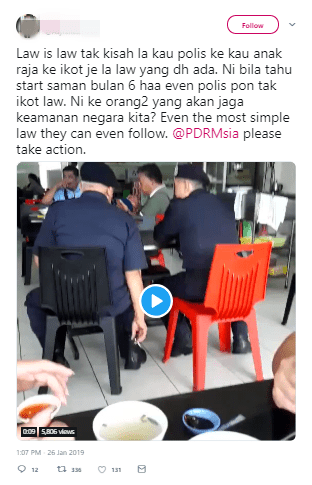 Netizens Triggered At Video Of Cops Puffing Away At Eateries, Despite Smoking Ban - WORLD OF BUZZ 1