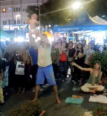 Ang Mo 'Begpackers' Seen Doing Stunts with Baby for Money in Bukit Bintang - WORLD OF BUZZ 2