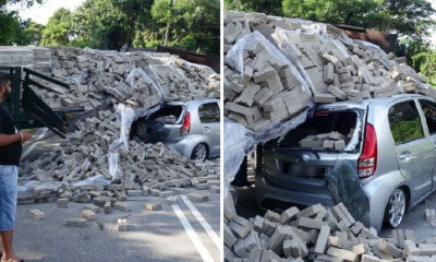 Lorry's Stalled Engine Causes Heavy Load Of Bricks to Fall on Passing Perodua Myvi - WORLD OF BUZZ