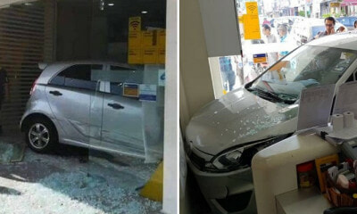 Woman Accidentally Pressed Accelerator When Parking, Rams Her  into Bank in Kulai and Injuring Two People - WORLD OF BUZZ