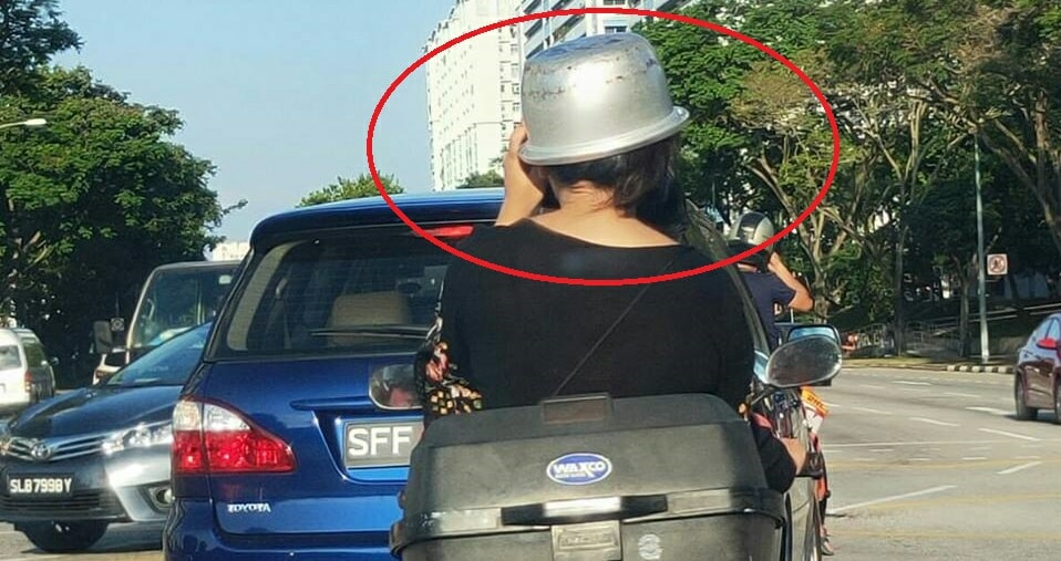 Woman Gets Creative & Uses Rice Cooker Pot As Helmet While Riding Pillion On Bike - World Of Buzz