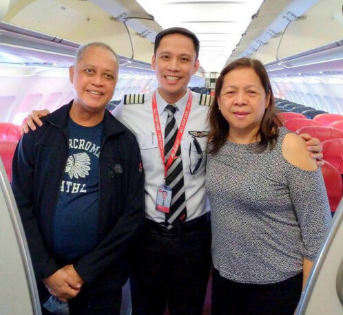 Air Asia Pilot Surprises Parents With Touching Announcement On Their First Flight Together - WORLD OF BUZZ 1