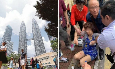 Chinese Tourist Falls Victim to Snatch Theft While Walking Near KLCC, Suffers Bad Head Injuries - WORLD OF BUZZ 1
