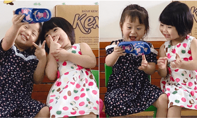 Cuteness Overload: Watch Two Girls Pretend To Take Selfie Using Slipper - WORLD OF BUZZ 1