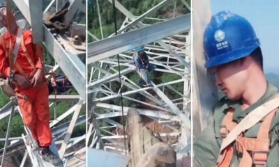 Fearless Electric Workers Take a Nap 164 Feet in the Air With Only Ropes to Support Them - WORLD OF BUZZ 1