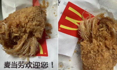 Girl Gets Choked By a Mouthful of Feathers While Biting Into McDonald's Chicken - WORLD OF BUZZ