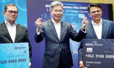 M'sians Can Now Access 17 Foreign Currencies With RHB's New Debit Cards - WORLD OF BUZZ