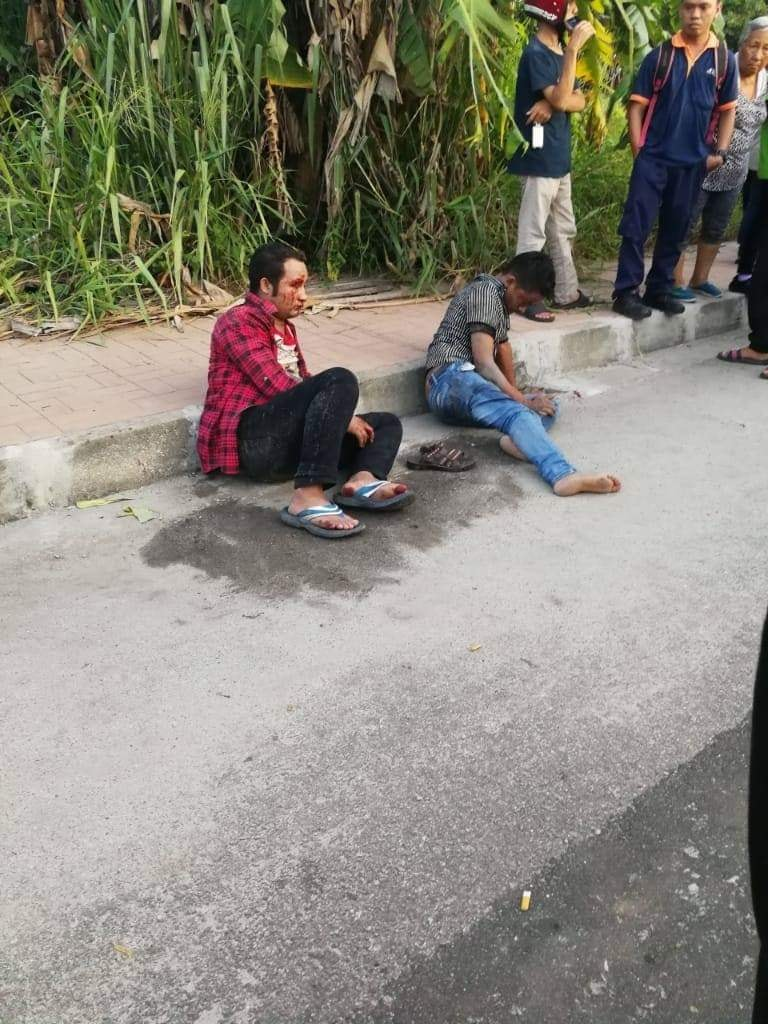 Passersby Beat Up 2 Foreign Workers for Molesting Female Driver in Penang - WORLD OF BUZZ