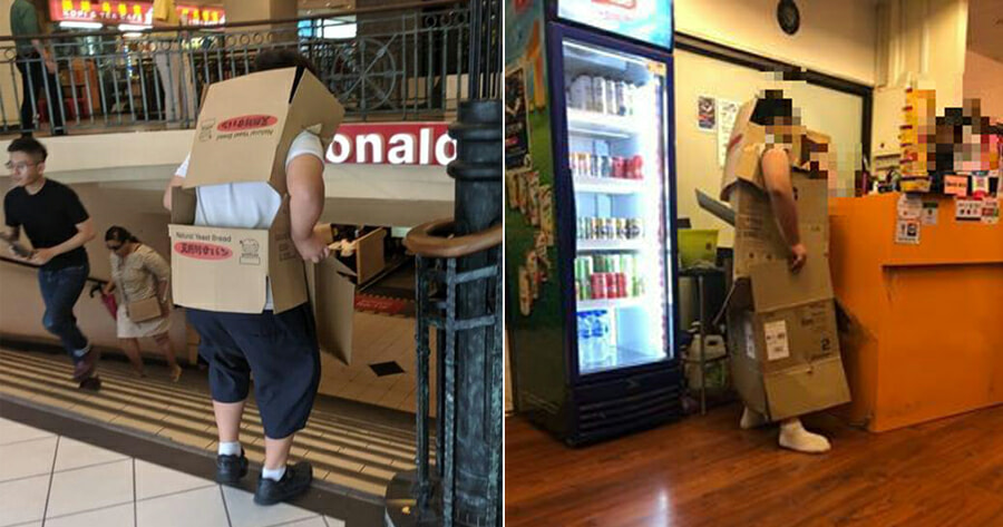 Boy Uses Cardboard Boxes to Cover School Uniform So That He Can Enter Cyber Cafe - WORLD OF BUZZ
