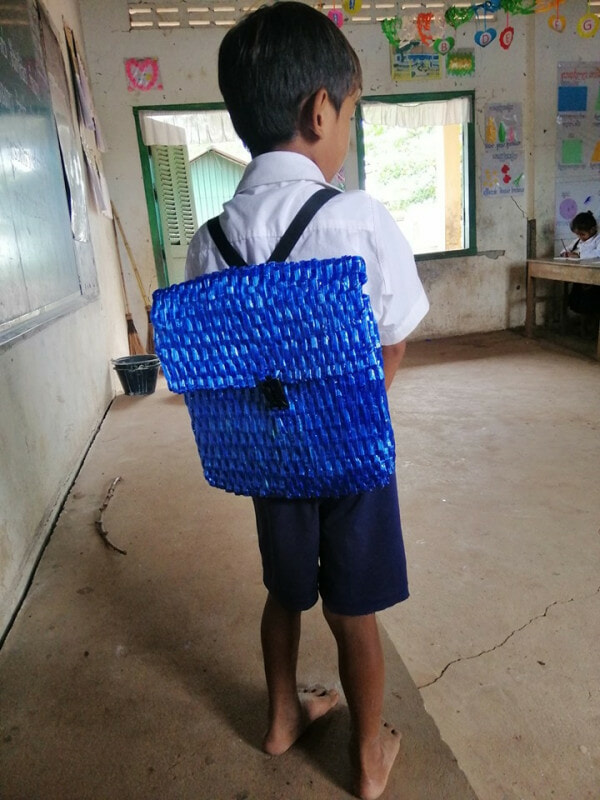 Father Can't Afford to Buy His Son A School Bag, So He Made One Using Only Raffia String - WORLD OF BUZZ 4