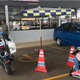A Traffic Police Motorbike And Tent Obstructing A Disabled Parking Space At An RNR - WORLD OF BUZZ 2
