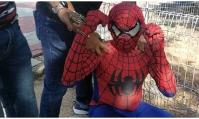 Illegal Immigrant 'Spider-Man' in Malacca Charged Tourists For Pictures, Gets Arrested by the Immigration Department - WORLD OF BUZZ 1