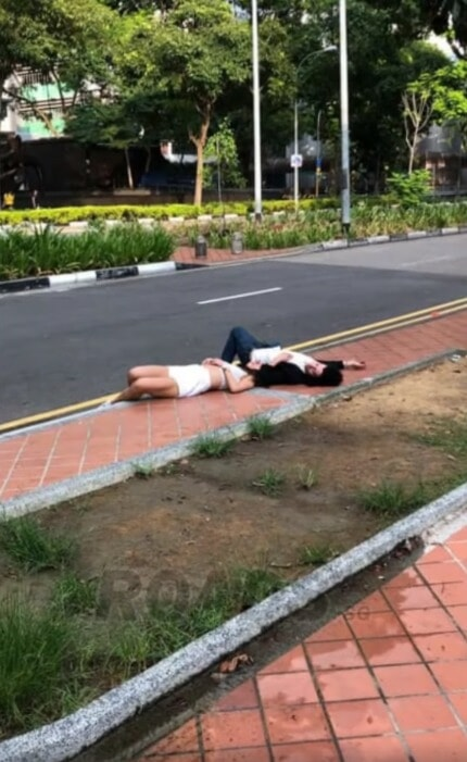 Man Finds Couple Passed Out By The Roadside, They're So Drunk That His Shouts Couldn't Wake Them Up - WORLD OF BUZZ