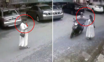 [VIDEO] M'sian Woman Mindlessly Crossed Road While Looking at Phone, Snatch - WORLD OF BUZZ