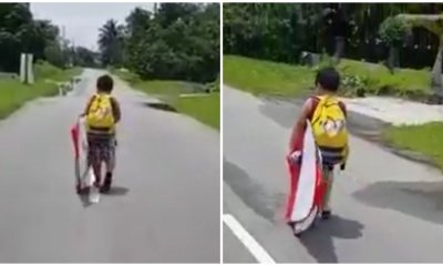 Watch: Little Boy's Failed Attempt To Run Away From Home, Gives The Grouchiest Face Ever - WORLD OF BUZZ