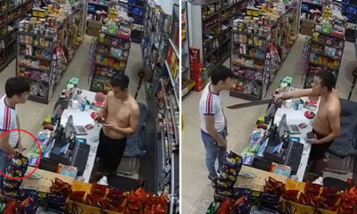 Watch: Would-be Robber Pulls Out Knife, Shopkeeper Takes Out a Half-Metre-Long Parang In Return - WORLD OF BUZZ 4