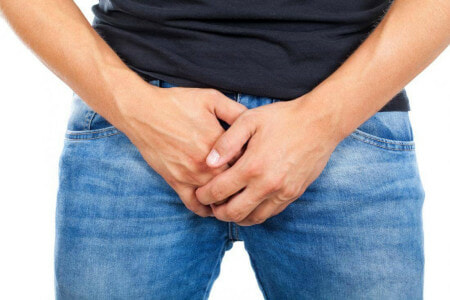 Man Holding His Groin