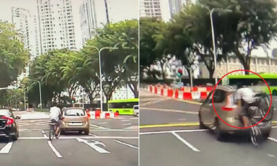 Watch: Cyclist Face Plants Into Car That Stopped At Red Light, Netizens In Stitches - WORLD OF BUZZ